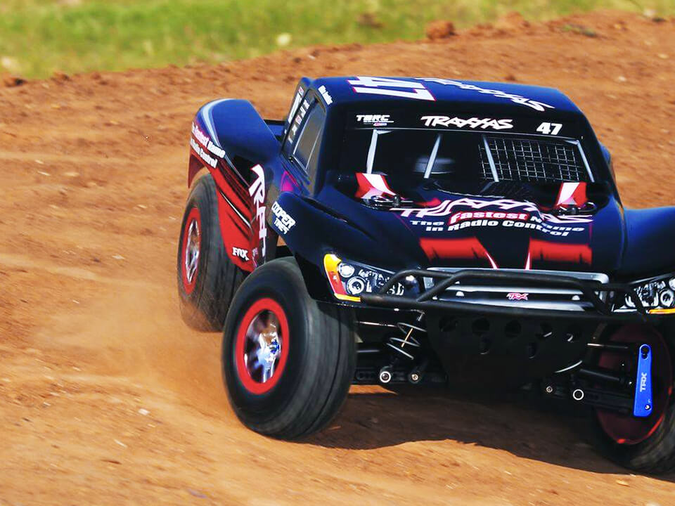 Baha Remote Controlled Race Car Driving On Dirt Track Featured on BigCommerce SEO Company Website