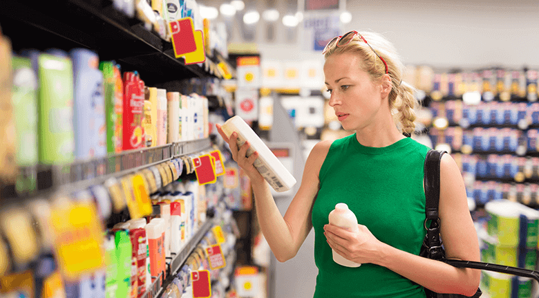 A Woman Picking Out A Product In A Grocery Store