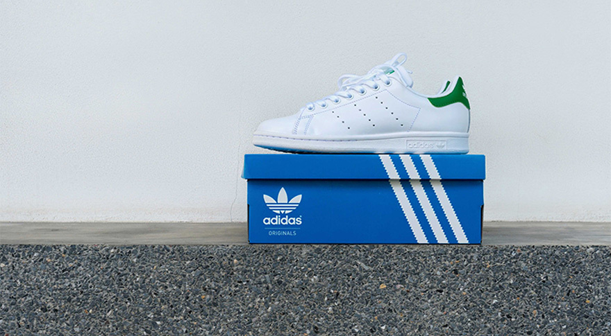 Designer Shoe On Blue Box In Front Of White Wall
