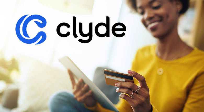 Clyde Extended Warranties Logo Over Agency Photo of Woman Wearing Yellow Shirt