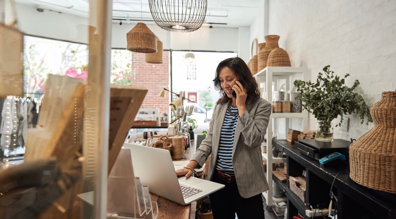 Female Store Owner Planning Retail Operations On Laptop