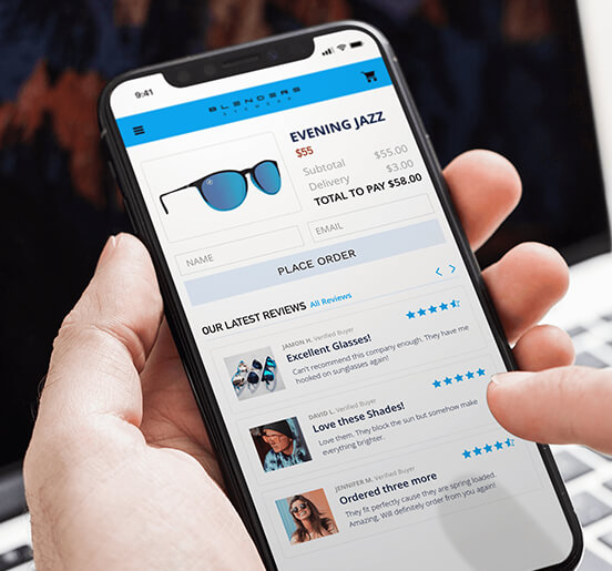 Ecommerce Applications Showing Sunglasses And Reviews On A Cellphone