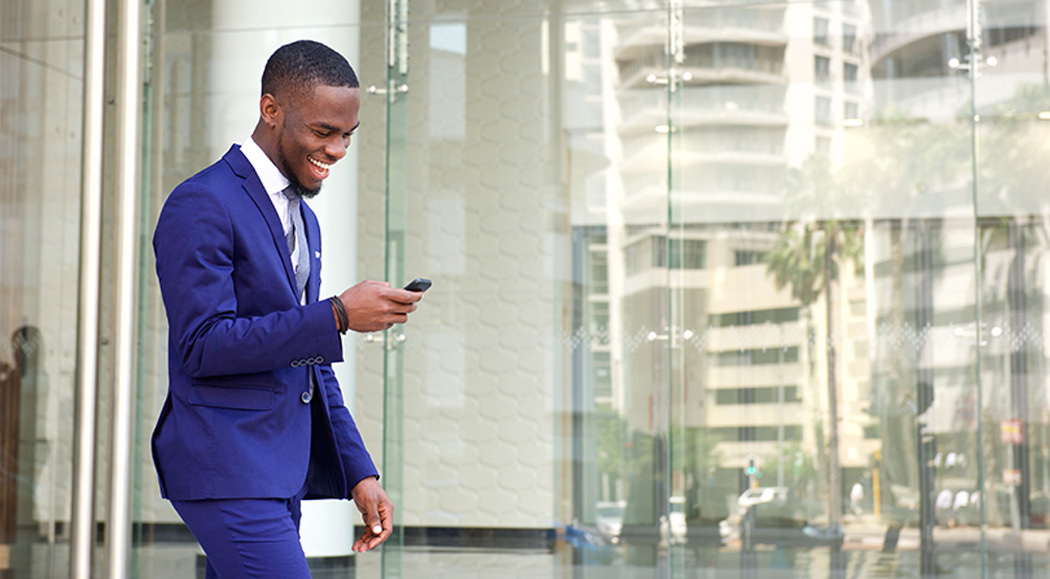 Business Owner Reading Emails On His Phone