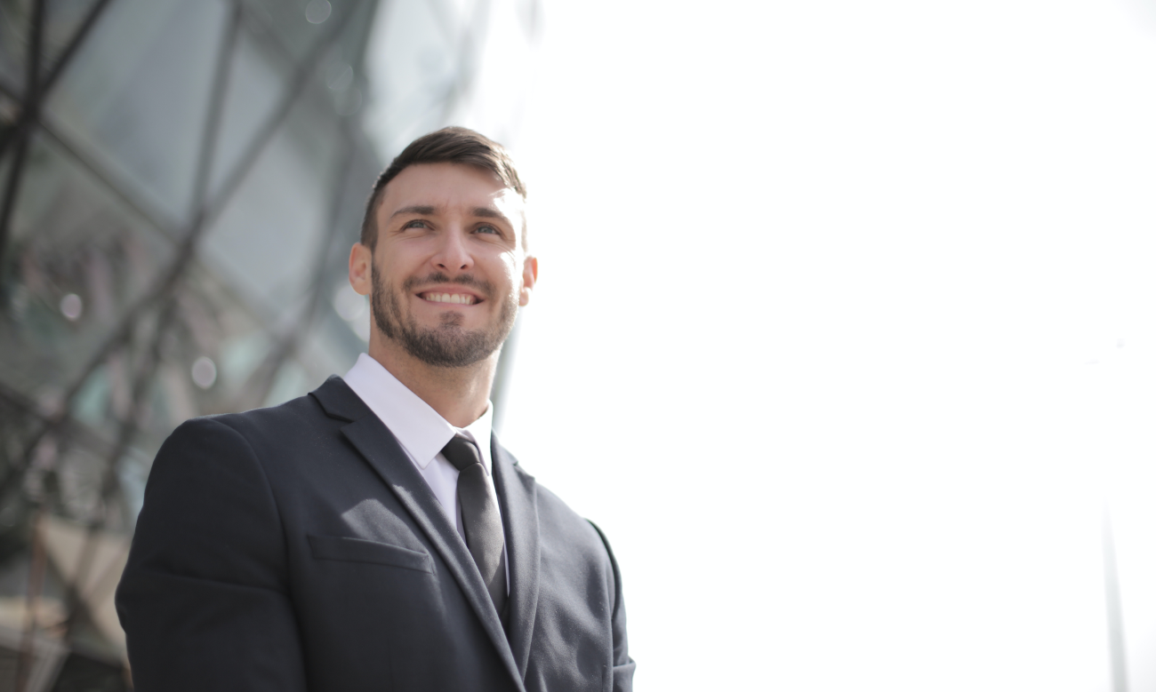 Smiling Marketing Expert Dressed in a Nice Suit