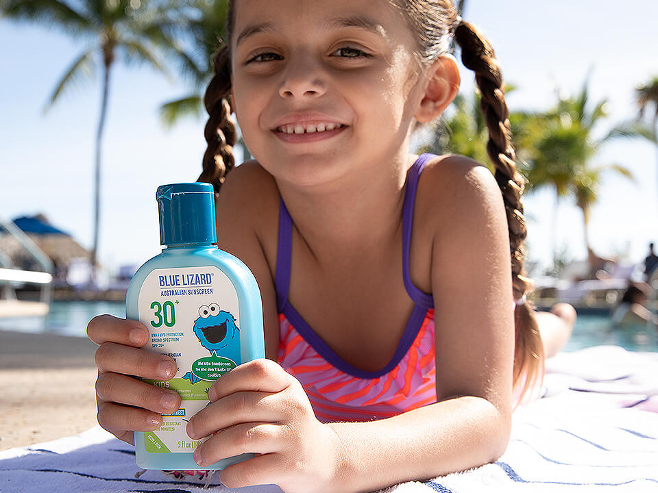 Girl Holding Sunscreen Bottle Outside at Pool for Influencer Agency Photo