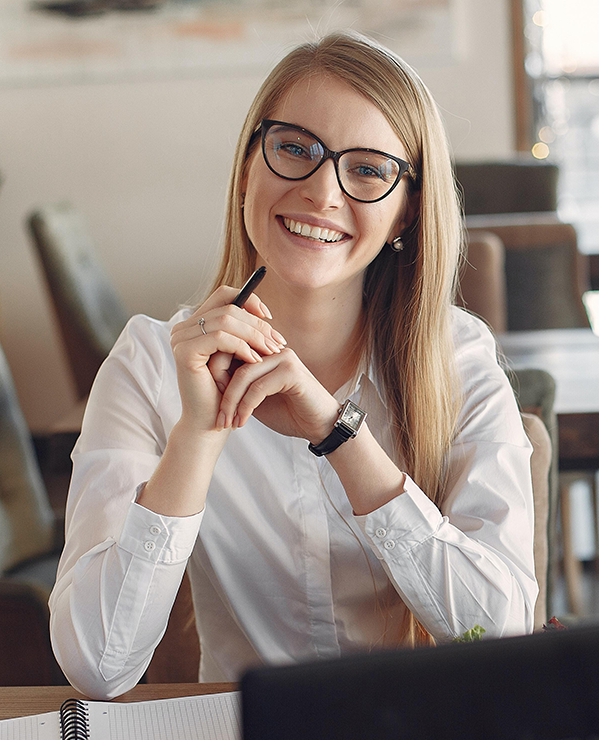 Smiling Marketing Expert Keeping Pen and Thinking About Marketing Strategy