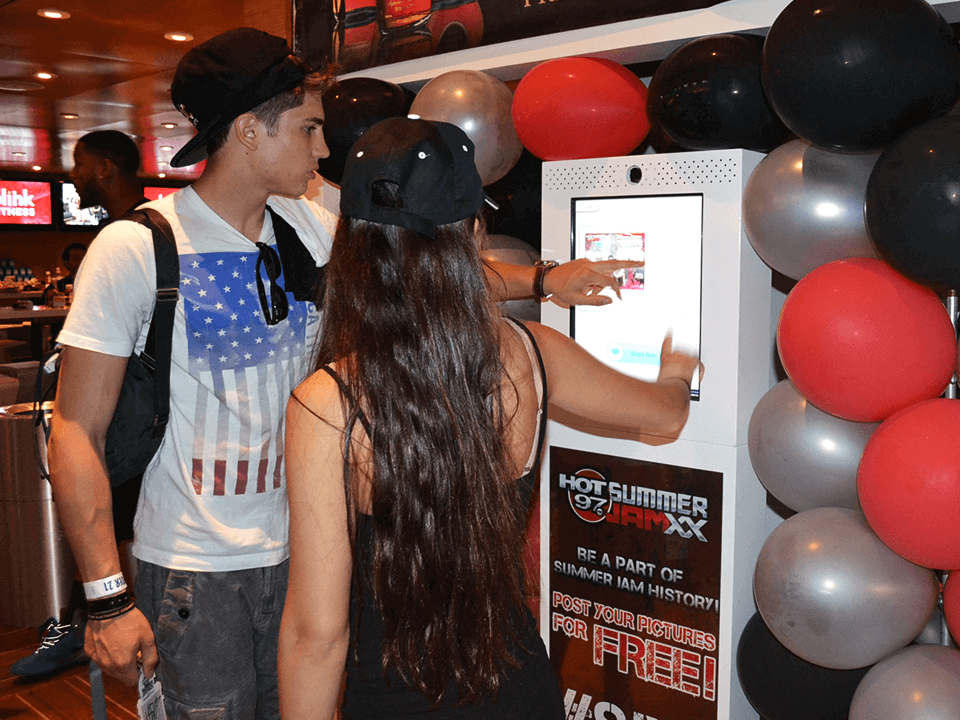 Concert Event Marketing Services Showing A Couple At A Photobooth for Concert Promoter