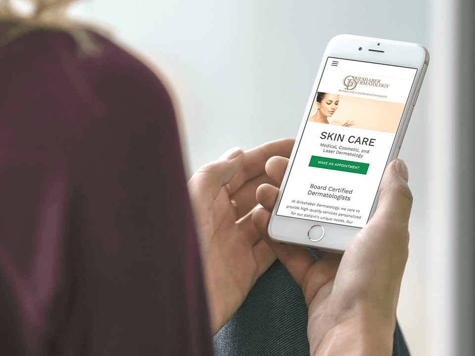 Woman Holding SmartPhone Viewing Dermatology Marketing Agency Design of eCommerce Website