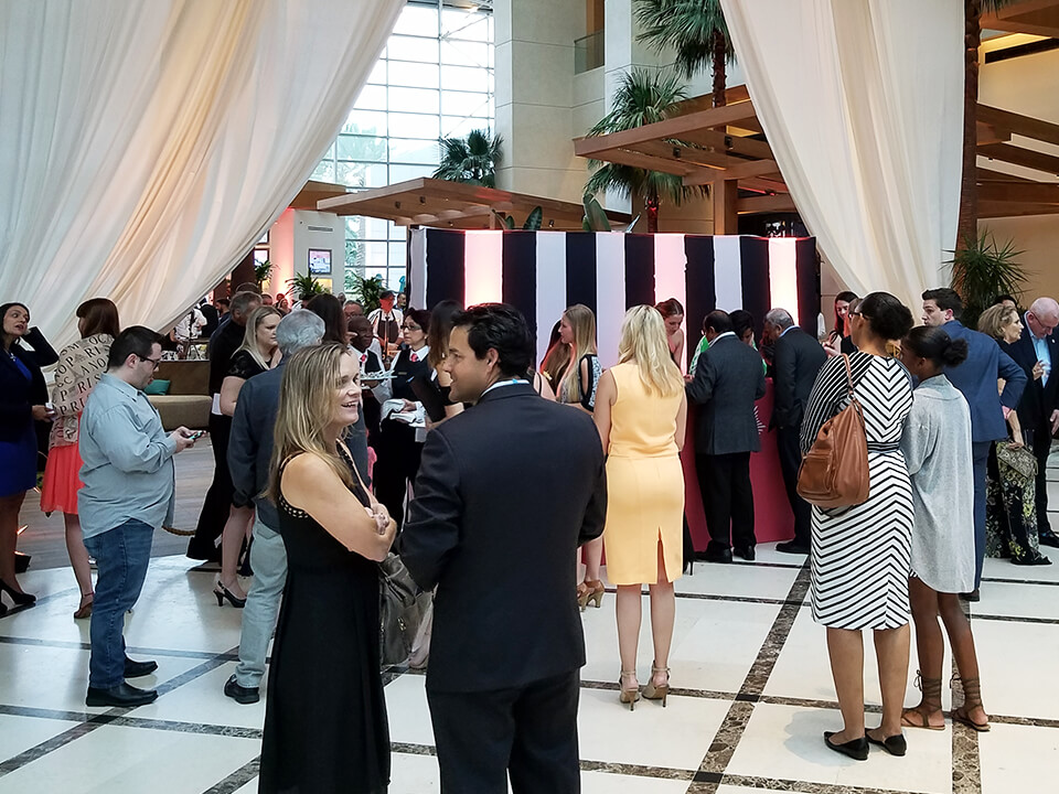 Social Media Agency Photo of Event for Hotel Brand With People Standing