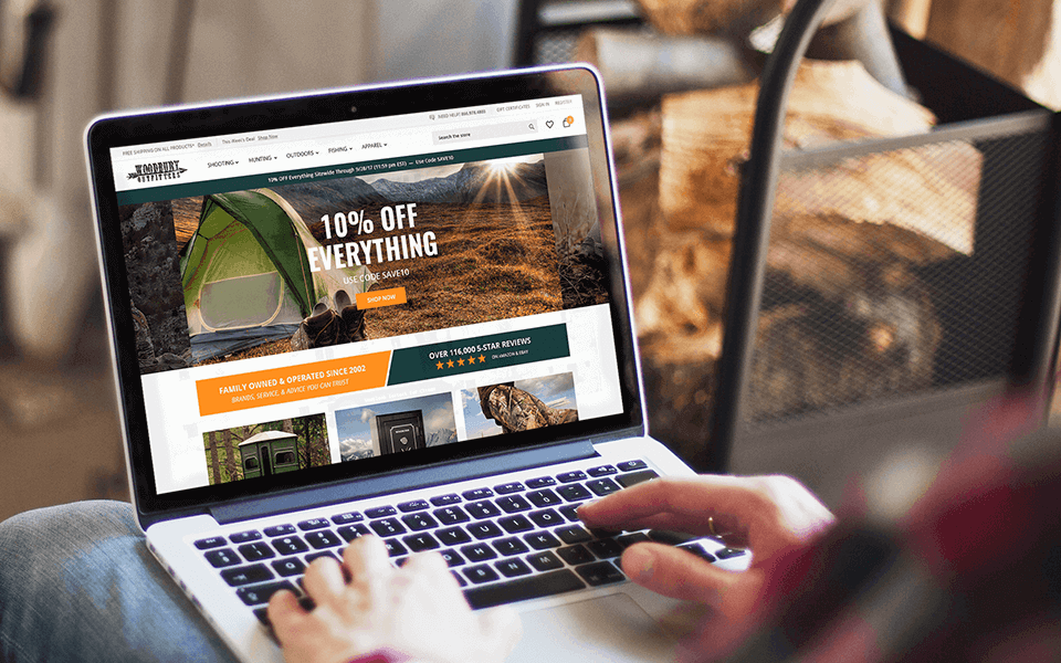 Outdoor Brand Website on BigCommerce Shown Over A Render Of Hunting Guy Holding Laptop