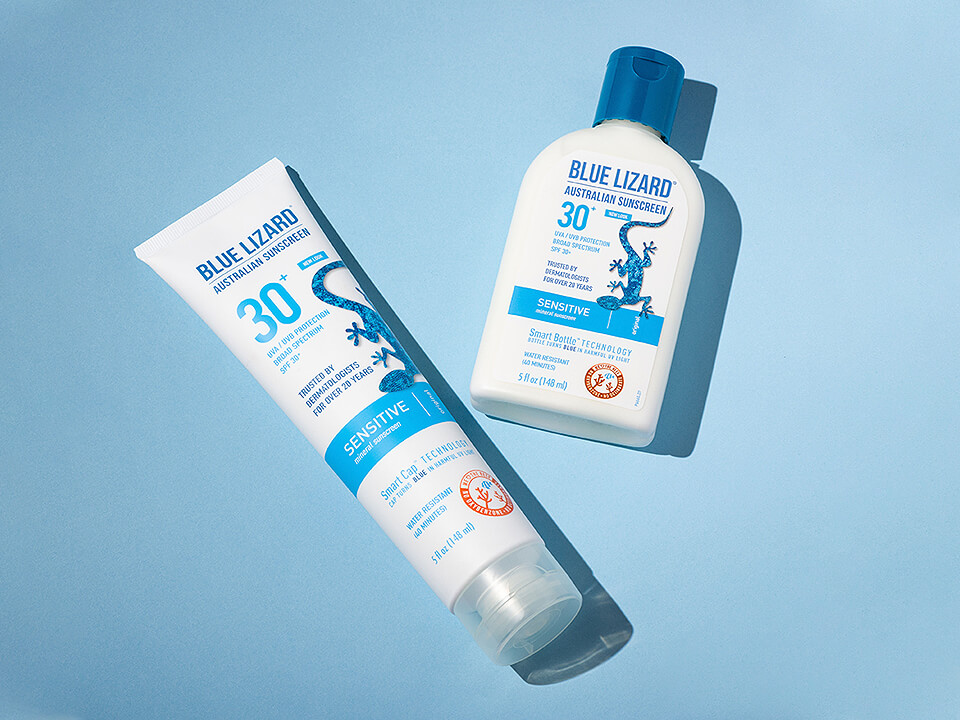 Product Packaging Company Photo of 2 Sunscreen Tubes on Blue Background