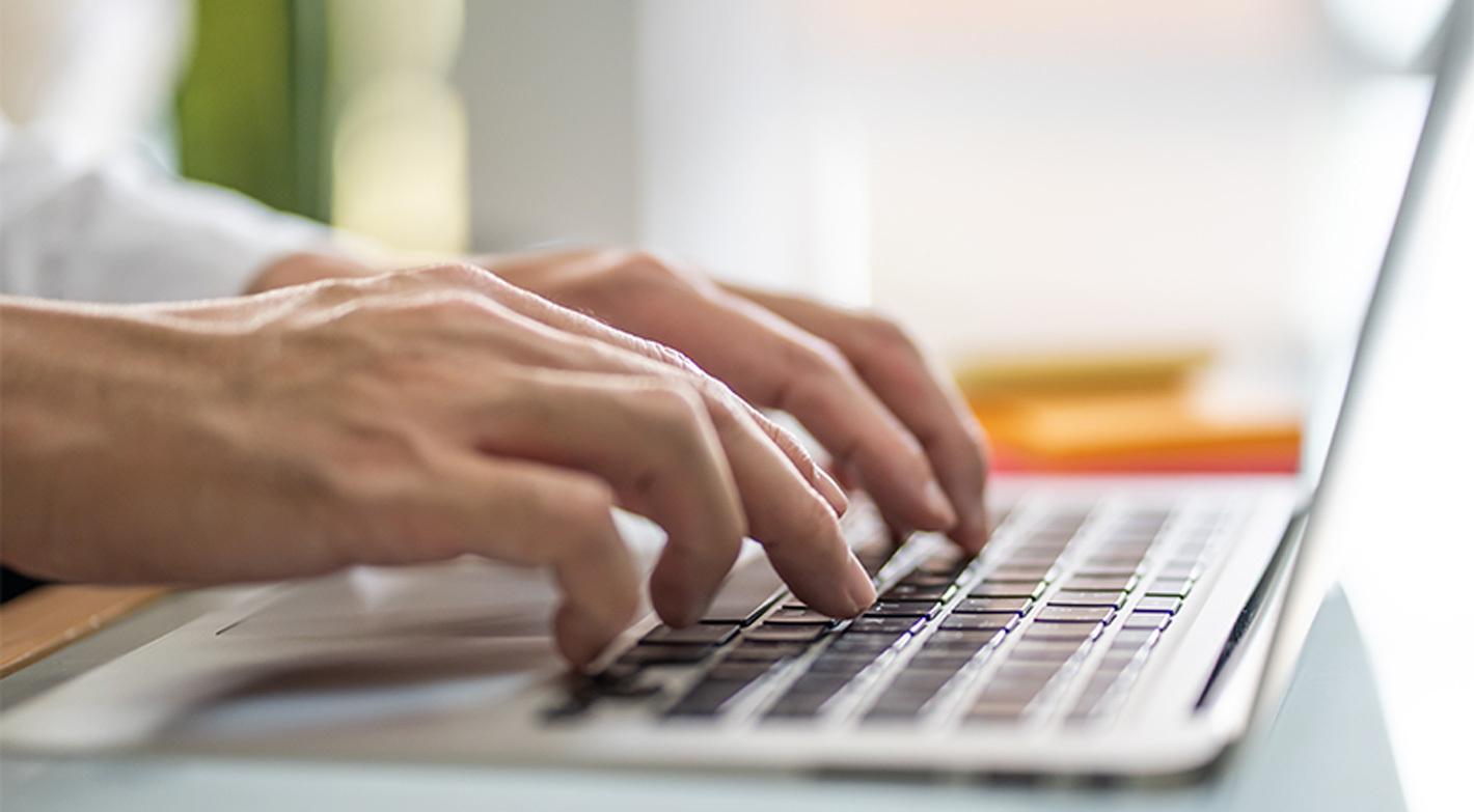 Search Engine Optimization Expert Typing On Laptop Keyboard