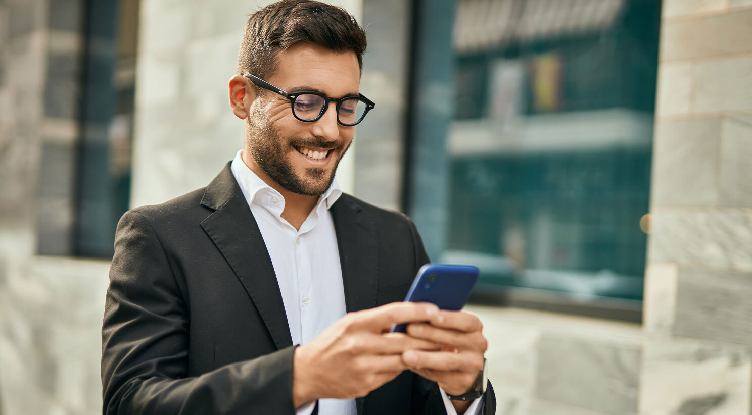Business Owner Reading SMS Marketing Campaigns On His Phone