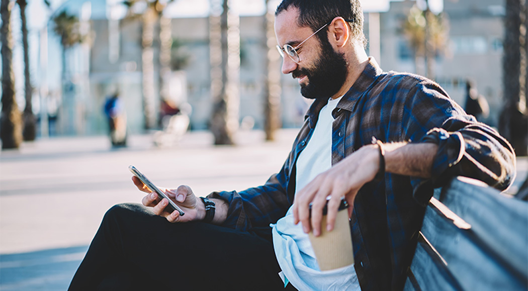 Young Man Searching Online On Mobile