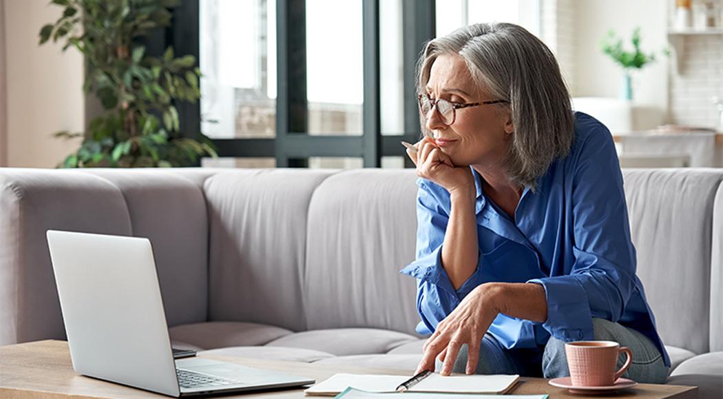 Female Content Writer Wearing Blue Shirt Working On Marketing Blogs
